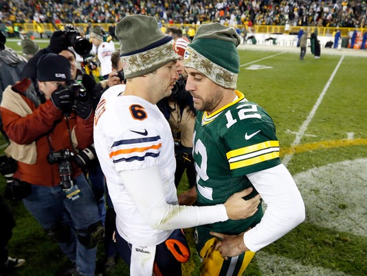 Chicago Bears quarterback Jay Cutler (6) and Green Bay Packers quarterback Aaron Rodgers (12) talk after an NFL football game Sunday, Nov. 9, 2014, in Green Bay, Wis. The Packers won 55-14. (AP Photo/Mike Roemer)