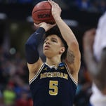 With little experience, Michigan hoops closing out close NCAA games