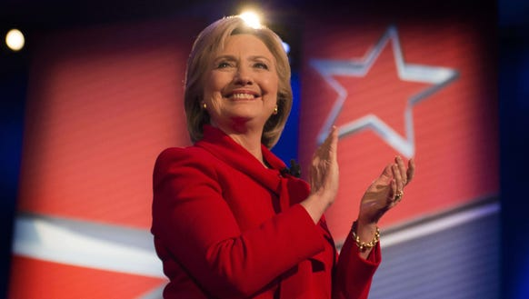 Hillary Clinton applauds during the CNN Town Hall at