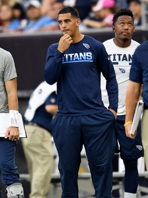 Titans quarterback Marcus Mariota stands on the sideline with an injured hamstring during the fourth quarter Sunday, Oct. 1, 2017.