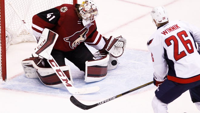 Arizona Coyotes' Goalie Mike Smith makes a save as the Arizona Coyotes face off against the Washington Capitals on Saturday, April 2, 2016, at Gila River Arena in Glendale.