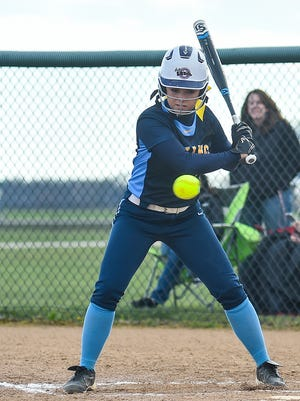 River Valley junior Morgan Lott watches a pitch during a regular season game against Harding. Lott was named honorable mention All-Ohio in Division II softball. She was an honorable mention pick in girls basketball this year, too.
