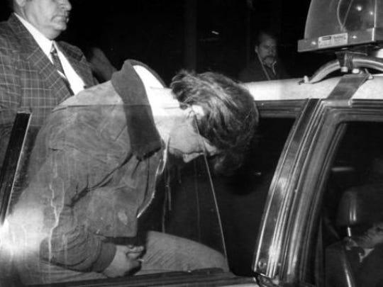 Richard LaBarbera taken into police car in 1980 for the murder of Paula Bohovesky.