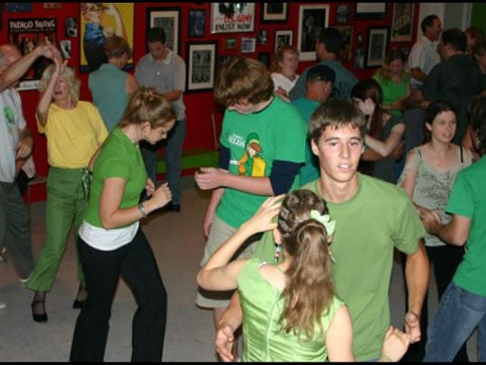Guests dance at an event at The Green Door, a swing