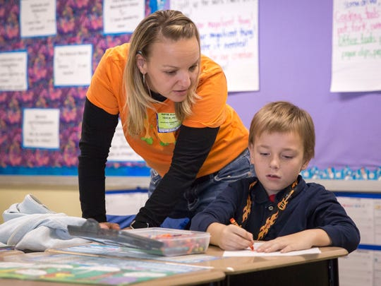 Students at Inspire Academy work on different assignments on Oct. 13 inside the school at 2801 E 16th St. The academy is a public charter school sponsored by Ball State University that offers grades K–5.