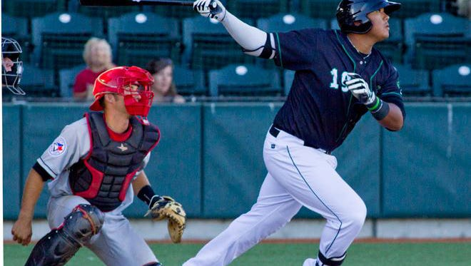 In this file photo, Trae Santos tracks the ball after connecting in a game for the Eugene Emeralds.  Santos started a Spring Training game for the San Diego Padres on March 23.