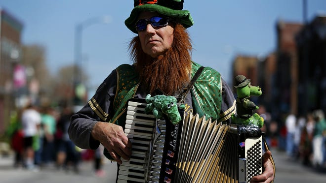 Jim Swain plays his accordion in the 2017 St. Patrick's Day Parade. This year's parade falls on St. Patrick's Day!