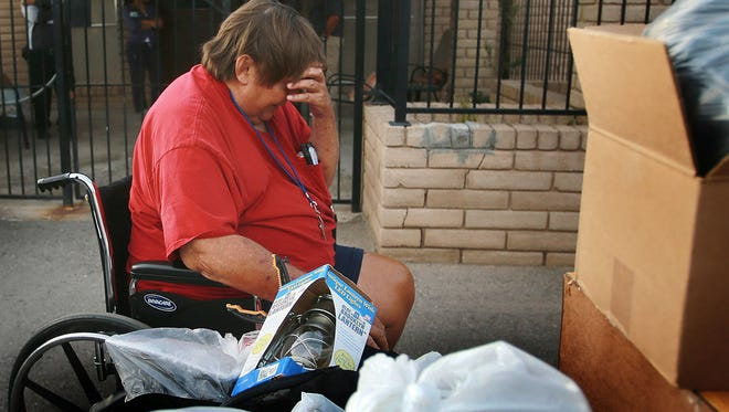 James Paternoster, who had been a resident of the Oasis Nursing and Rehabilitation Center, seemed overcome with emotion as he looked through his belongings outside the center Thursday. Paternoster was apparently evicted Thursday and his belonging were left outside the building.