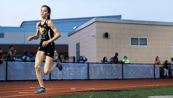 Padua's Lydia Olivere races to a first place finish Girls 3200 Meter Run event at the Meet of Champions at Dover High School on Wednesday evening.