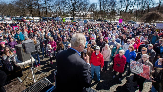 Sen. Tom Carper speaks to hundreds of people gathered at a rally to support the Siegel Jewish Community Center on Sunday afternoon. The rally was formed after a series of bomb threats were made against the center and others across the country.
