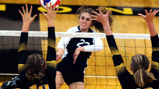 Dallastown's Lydia Stump tries to slam past Red Lion's Julia Beiler (10) and Sophie Guthrie during volleyball action at Red Lion Tuesday, Sept.5, 2017. Bill Kalina photo