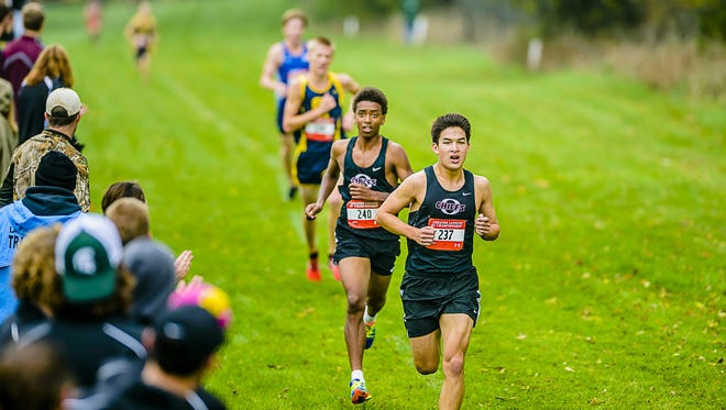 Paul McKinley ,237, runs just in front of teammate Saano Murembya at the Greater Lansing Championships last fall. McKinley and Murembya have been the top runners this fall for Okemos, which leads the team coaches' rankings.
