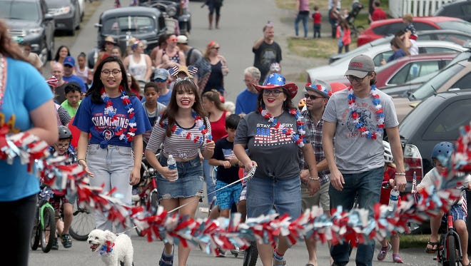 Participants in the Fourth of July Parade in Keyport make their way up the first hill on Pacific Avenue in Keyport on Wednesday.