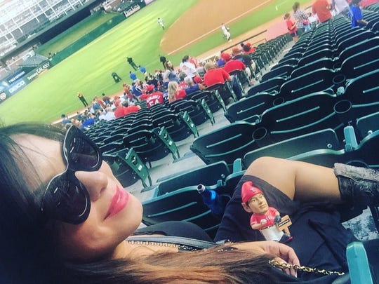 In this 2015 photo, Belkis Mariela Rodriguez watches the Tigers play the Texas Rangers in Arlington.