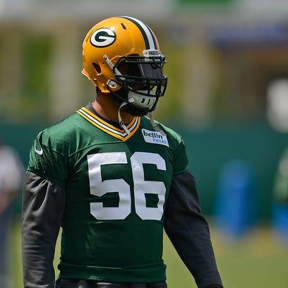 Green Bay Packers linebacker Julius Peppers looks on