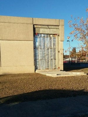 The section of exterior wall that fell in back of the Dickson County Library on Sunday.