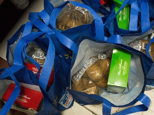 Casa de Peregrinos distributed all the food one would need for a Thanksgiving Day meal to 1,529 clients on Monday Nov. 20, 2017.