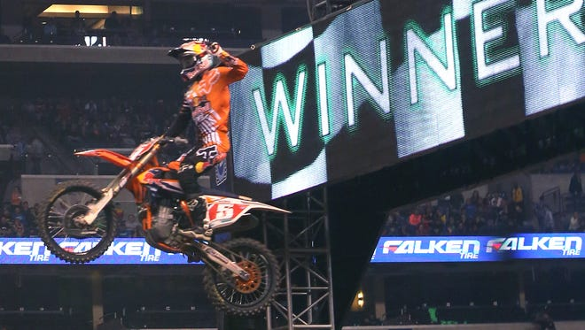 Ryan Dungey, winner of the 450SX race at the Monster Energy AMA Supercross Series at Lucas Oil Stadium in Indianapolis crosses the finish line on Saturday, March 14, 2015. Dungey, who won last year, is now a three-time series champ.