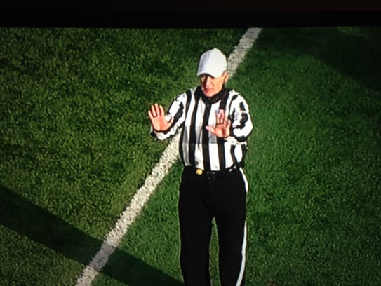 Referee Mike Cannon signals a very important pass-interference