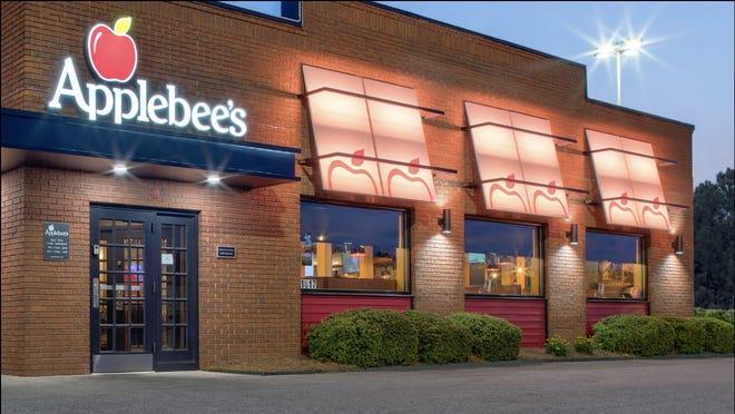 an exterior view of an Applebee's restaurant at dusk.