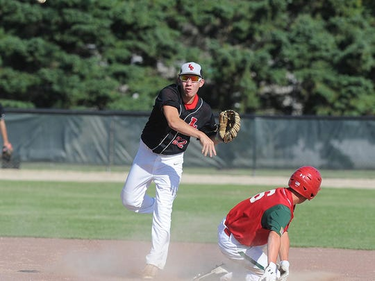 Lomira/Theresa's Alex Brath gets the force out at second, but fails to convert the double play against Berlin in the second inning Friday afternoon. Lomira/Theresa lost, 5-4, after giving up a two-run lead in the seventh inning.