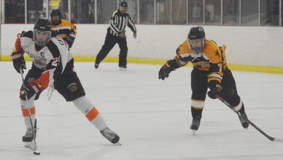 Michael Carducci (left) beats a St. Anthony's defenseman