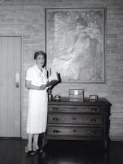 Desert Art Center supporter Pearl McCallum McManus stands in front of her portrait painted by Gordon Coutts.