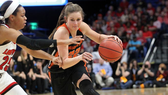 Oregon State's Kat Tudor, right, drives on Louisville's Asia Durr during the first half of an NCAA women's college basketball tournament regional final, Sunday, March 25, 2018, in Lexington, Ky.