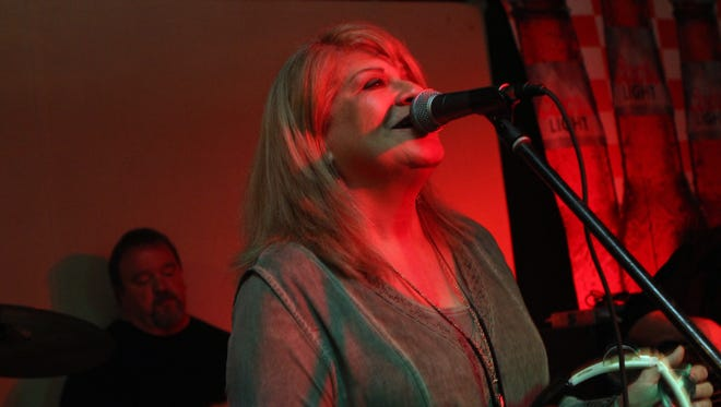 Cindy McElroy performs at a fundraiser for Mike Robinson at Oneal's on Saturday.