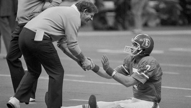In this Jan. 15, 1978, file photo, Red Miller, coach of the Denver Broncos, shakes hands with his quarterback, Craig Morton, during the team's warm-ups before NFL football's Super Bowl XII against the Dallas Cowboys in New Orleans. Miller, the fiery head coach who led the Broncos to their first Super Bowl, has died after complications from a stroke. He was 89.  (AP Photo/File)