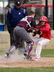 Genoa catcher Rylen Stoner makes a tag at home plate.