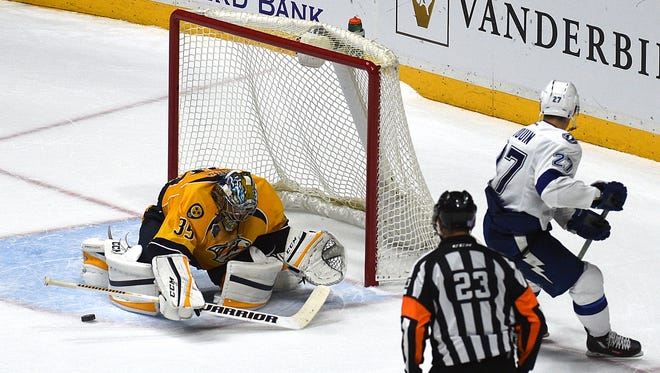 Predators goaltender Pekka Rinne (35) stops a shot by the Lightning's Jonathan Drouin (27) in the shootout Tuesday.