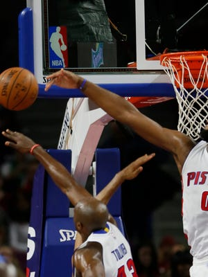 Pistons forward Anthony Tolliver and center Andre Drummond block shot by Magic forward Tobias Harris in the second half on Wednesday at the Palace.
