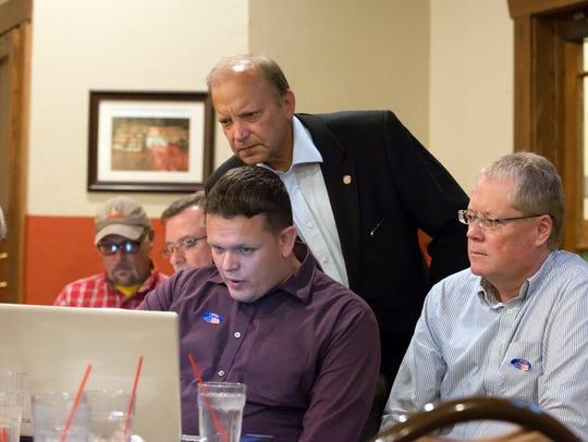 Keith Den Hollander, center, with Dr. John Bizon and