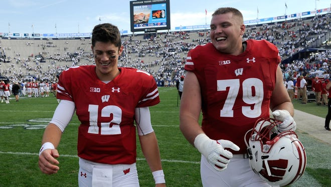 UW teammates Alex Hornibrook (left) and David Edwards are all smiles after a convincing win over BYU on Saturday in Provo, Utah.