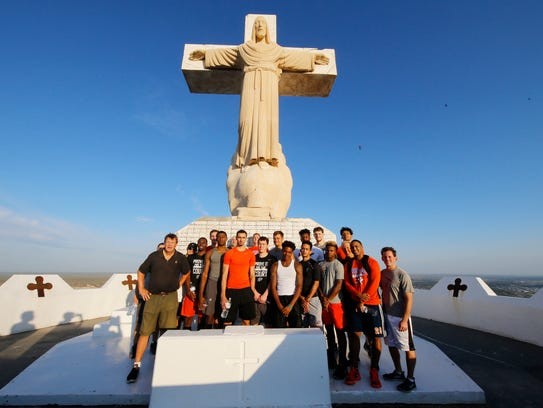 Members of the UTEP basketball team and coaches stand