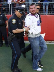 A fan is detained after fighting with police during the NFL game between the San Francisco 49ers and the New York Giants at Levi's Stadium on November 12, 2017 in Santa Clara, California.  (Photo by Ezra Shaw/Getty Images)