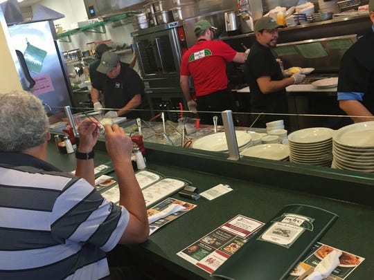 Cooks quickly become friends when you sit at the counter by the kitchen at Metro Diner.