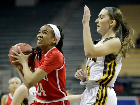 Kirkwood's Jayla Everett, left, drives past Kickapoo's Jordan Wersinger on her way to the basket during the first half of the Missouri Class 5 girls high school championship basketball game Saturday, March 19, 2016, in Columbia, Mo. (AP Photo/Jeff Roberson)