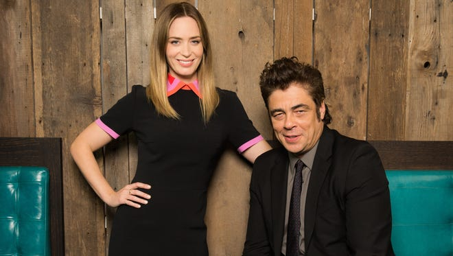 Emily Blunt and Benicio Del Toro are all smiles as they promote dark thriller 'Sicario.' The actors pose at Botequim restaurant at Hyatt Union Square in New York on Sept. 16, 2015.