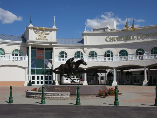 636336451170993823-1.-Entrances-to-Kentucky-Derby-Museum-and-Churchill-Downs.jpg