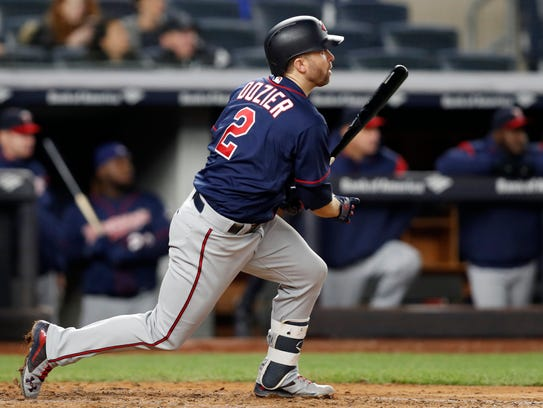 Minnesota Twins' Brian Dozier (2) hits a fifth-inning,