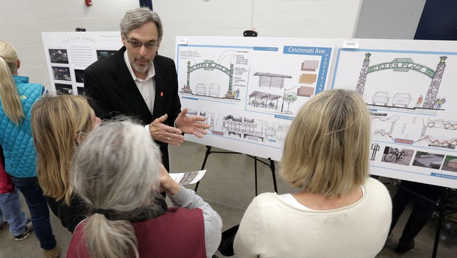 Architect Morris Brown talks about his designs as the city looks for input from Kern Place residents on the Sun City Lights project. Signage on the major corridors around El Paso will span the roadway welcoming visitors to certain parts of the city.