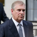 Two days after an intruder was discovered at Buckingham Palace, police confronted Prince Andrew, the second son of Queen Elizabeth II, in the royal residence's garden and demanded he identify himself.