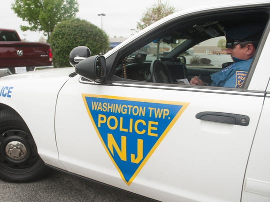 Washington Township Police Officer John Freitag writes a ticket after pulling over a motorist for using a hand-held cell phone while driving on Black Horse Pike near Greentree Road as Officer Freitag patrols the area as part of the township's Data-Driven Approaches to Crime and Traffic Safety (DDACTS) program.  04.28.16