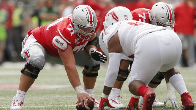 Ohio State center Josh Myers said he feels strongly that college football players should have the choice to play this season.