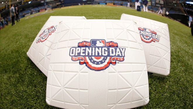 Opening Day bases lay on the field prior to the season's first game between the Yankees and Rays.
