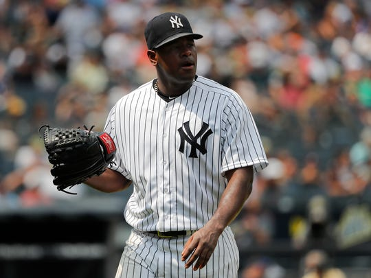 New York Yankees starting pitcher Luis Severino leaves the baseball game against the Kansas City Royals during the fifth inning, Saturday, July 28, 2018, in New York.