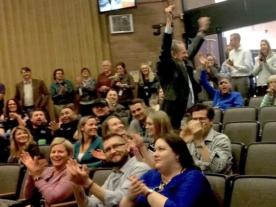 Kevin Gertig celebrates as Fort Collins employees learn the city has won the coveted Malcolm Baldrige Award for quality and excellence.