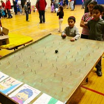 Mendel Hecht, 7, plays a game of Purim Roll, at the Annual Purim Celebration at the Jewish Community Center in Poughkeepsie on Sunday.